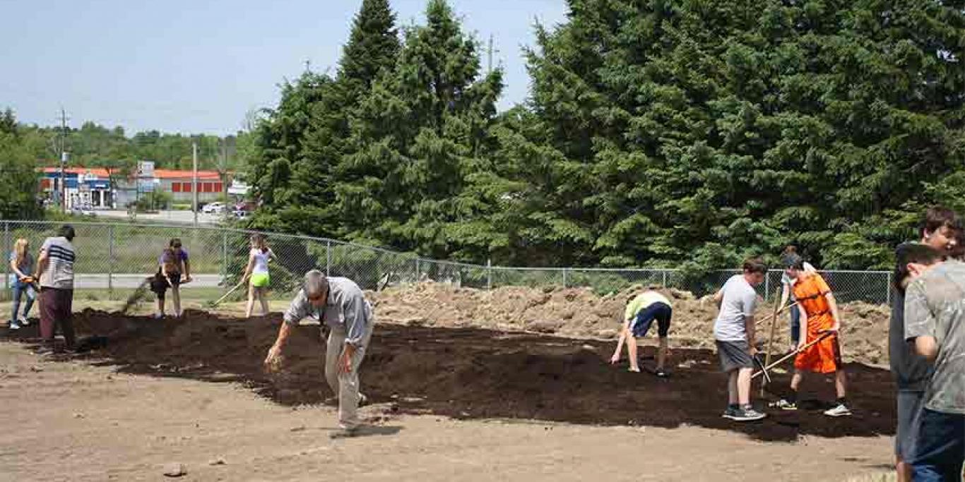 Volunteers preparing the garden bed