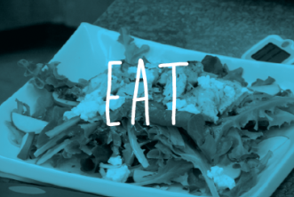 Image of salad with blue overlay. Text reads: EAT
