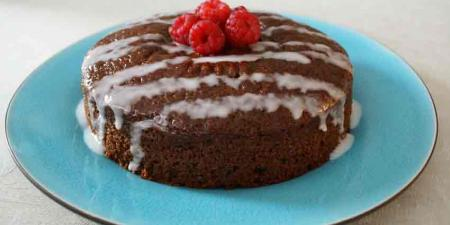 Picture of chocolate cake with raspberries on top